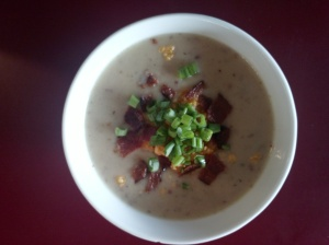 Baked Potato soup topped with bacon, cheddar cheese and green onion