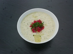Chilled Cucumber, a summer soup topped with chives and fresh tomatoes